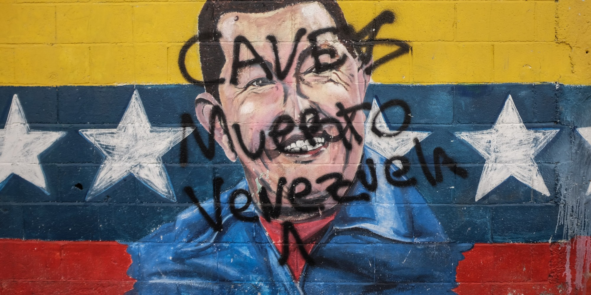 Picture of a graffiti depicting late Venezuelan President (1999-2013) Hugo Chavez, taken in Caracas on November 2, 2015.    AFP PHOTO / FEDERICO PARRA        (Photo credit should read FEDERICO PARRA/AFP/Getty Images)